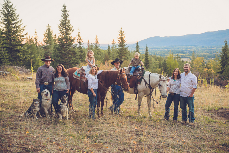 Western Pleasure Guest Ranch family picture with 6 adults and 2 children sitting on horses