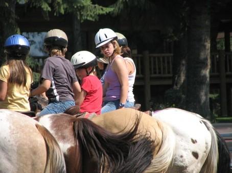 Children learning on horseback
