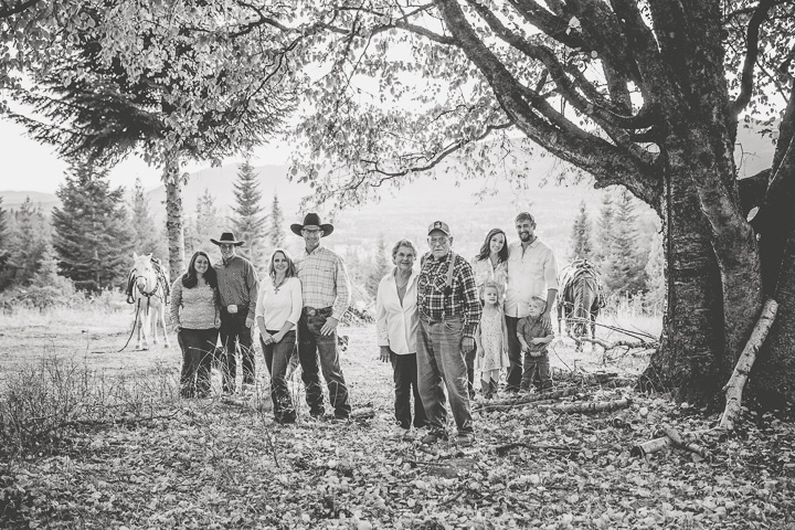 Black and white ranch family photo with grandparents, children and grandchildren